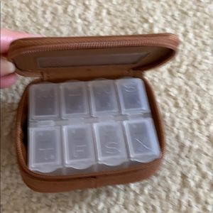 Rolfs small pill holder. Great for travel!